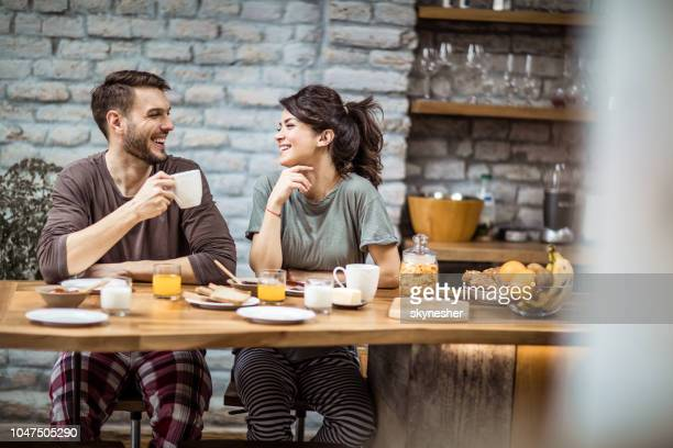 happy couple talking during morning coffee at home. - nightwear stock pictures, royalty-free photos & images