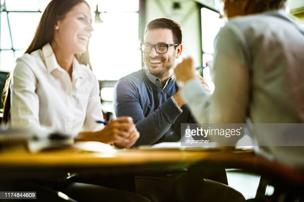 happy couple talking to their insurance agent on a meeting in the office. - advice stock pictures, royalty-free photos & images