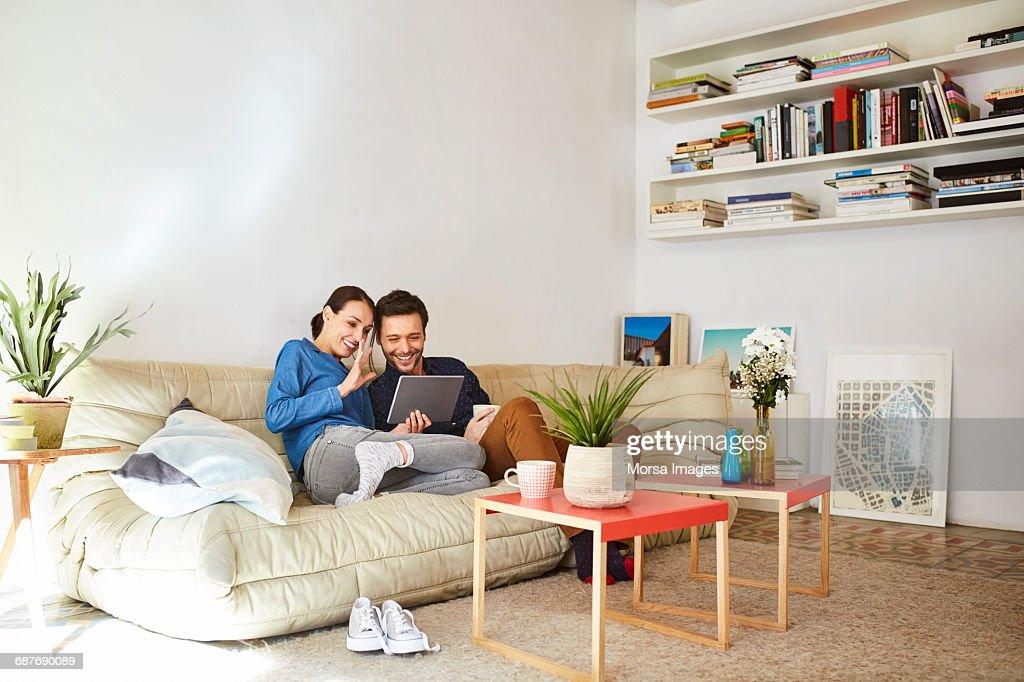 Happy couple video chatting on digital tablet : Foto de stock