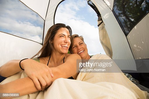 Happy couple wake up in tent