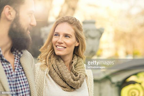 happy couple walking around the city. - a fall from grace stock pictures, royalty-free photos & images