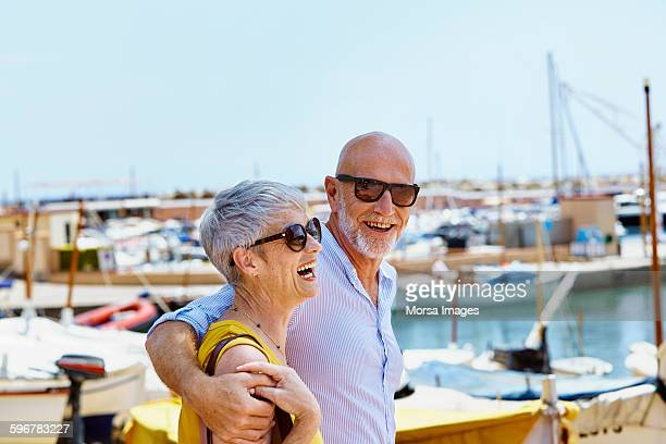 happy couple walking by harbor - spain stock pictures, royalty-free photos & images
