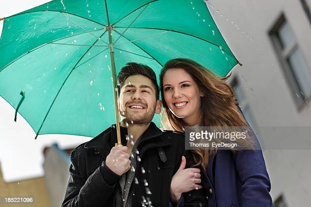 Happy Couple Walking in the Rain