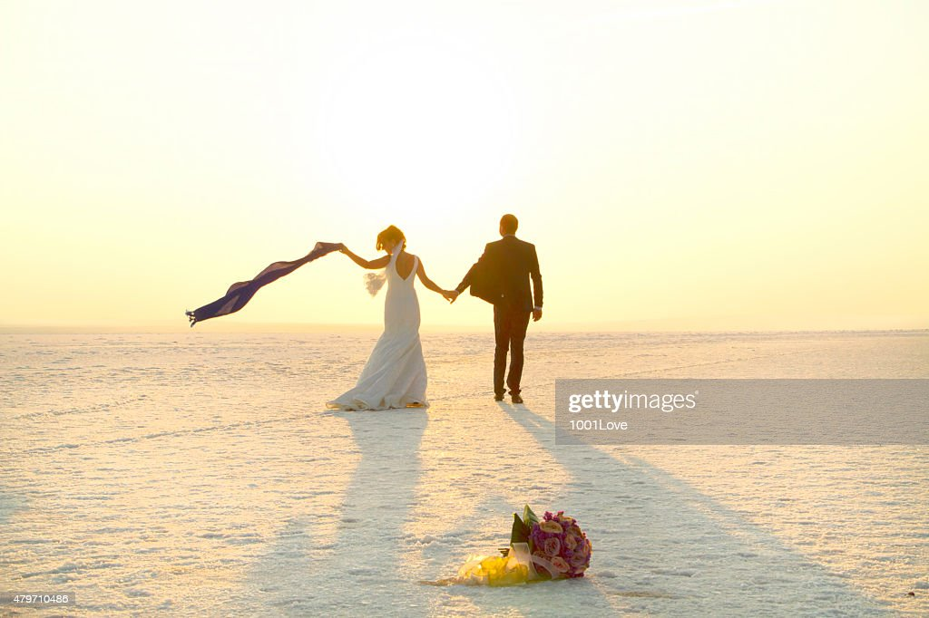 Happy couple walking on snow : Stock Photo
