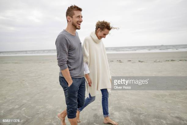 Happy couple walking on the beach