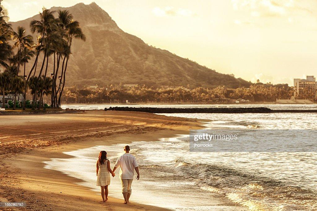 Happy Couple Walking on Waikiki Beach at Sunrise : Stock Photo