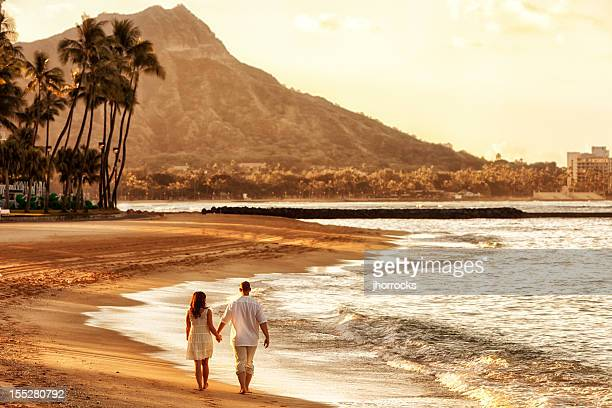 Happy Couple Walking on Waikiki Beach at Sunrise