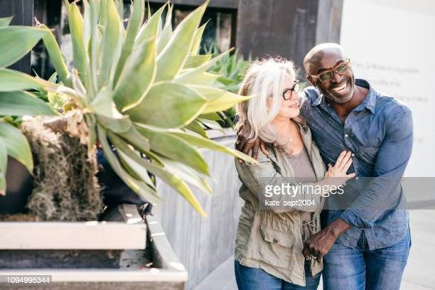 happy couple walking outdoor - mixed race person stock pictures, royalty-free photos & images
