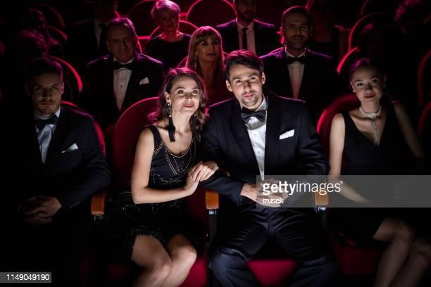 happy couple watching theatrical performance - opera stock pictures, royalty-free photos & images