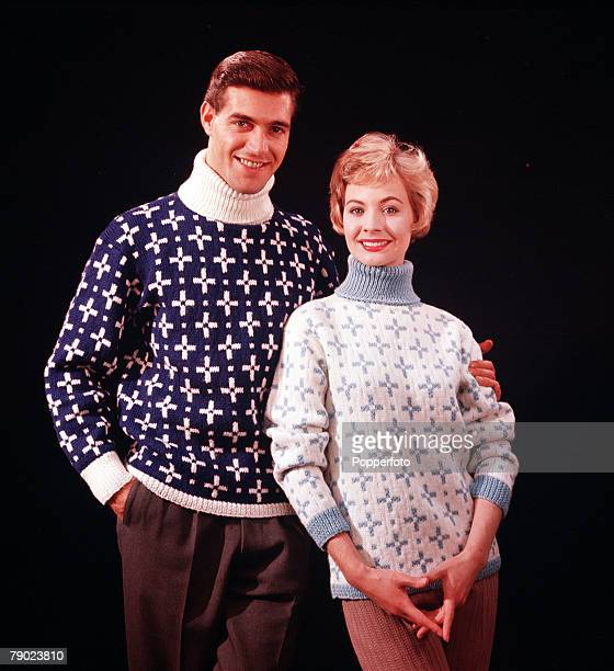 1959 A happy couple wearing knitted poloneck sweaters pose for the camera