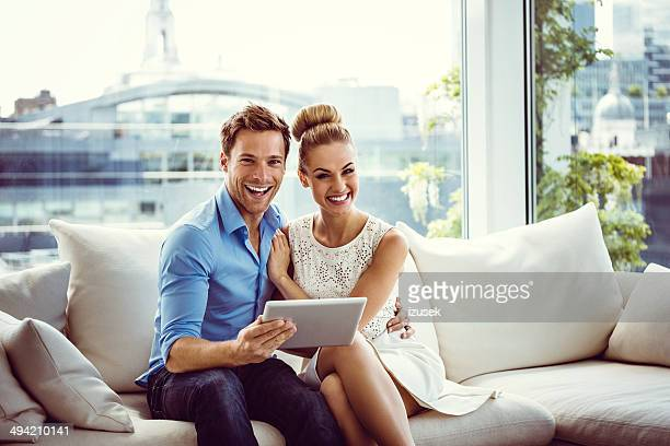 Happy couple with a digital tablet