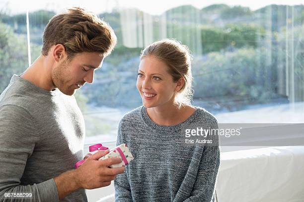 happy couple with birthday gift - husband stock pictures, royalty-free photos & images