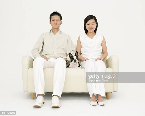 Happy Couple With Boston Terrier