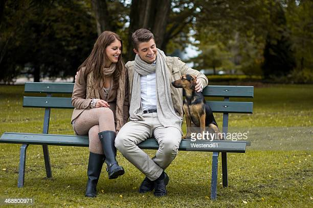Happy couple with dog in a park