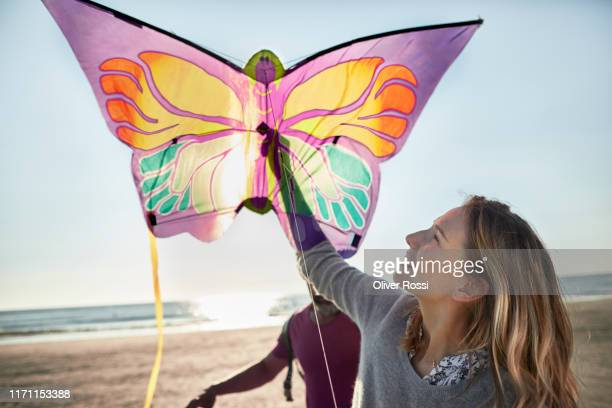 happy couple with kite on the beach - north sea stock pictures, royalty-free photos & images