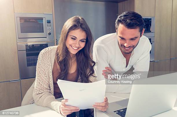 Happy couple with paperwork.