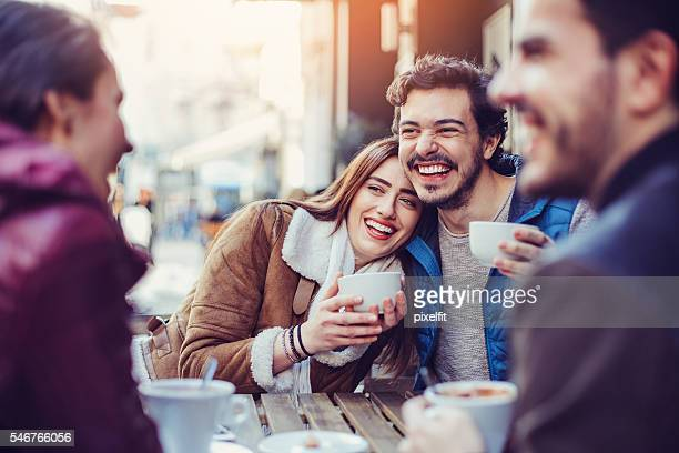Happy couples having coffee and tea