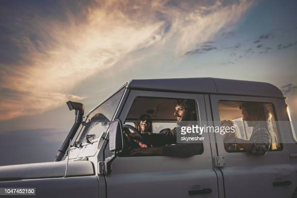 happy couples having fun on a road trip. - jeep stock pictures, royalty-free photos & images