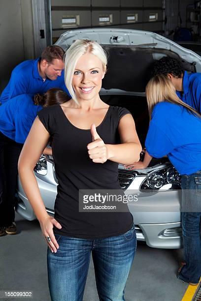 Happy customer at the body shop mechanic