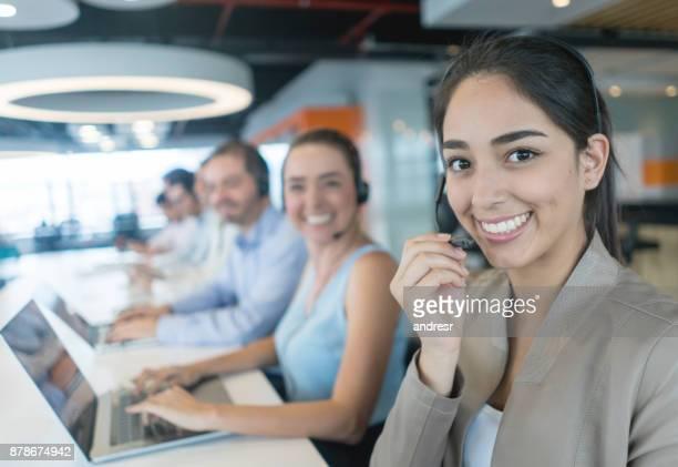 Happy customer service representative working at a call center