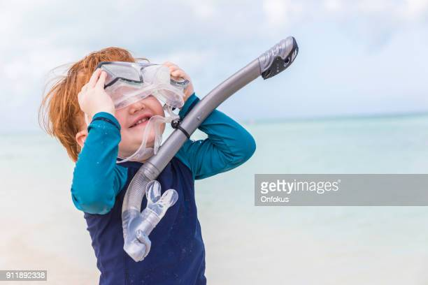 Happy Cute Little Boy Snorkel at Beach