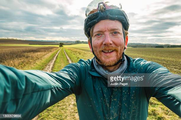 happy cyclist taking selfie on rural track - males stock pictures, royalty-free photos & images