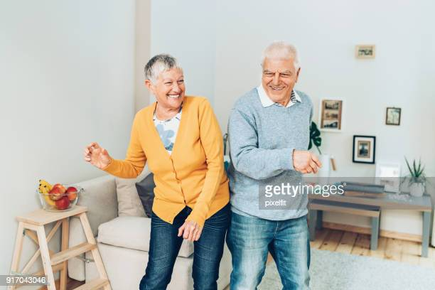 happy dance - young at heart stock pictures, royalty-free photos & images
