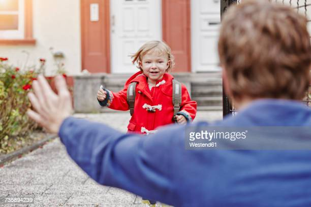 happy daughter approacing father at house entrance - divorce stock pictures, royalty-free photos & images
