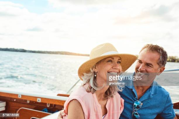 happy days out at sea - mature couple stock pictures, royalty-free photos & images