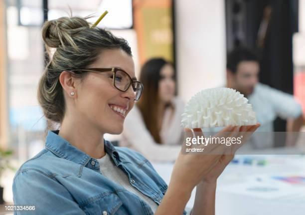 Happy designer looking at a 3D prototype