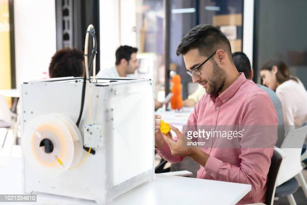 Happy designer using a 3D printer