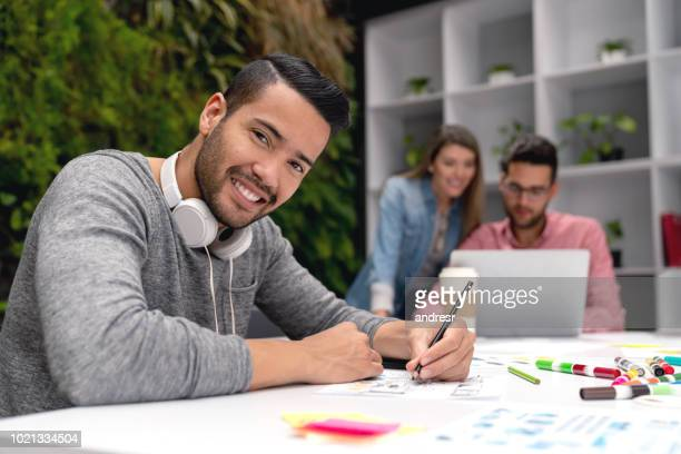 Happy designer working at a creative office