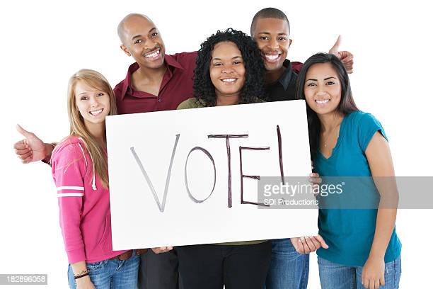 Happy Diverse Group of Young Adults Holding Vote Sign