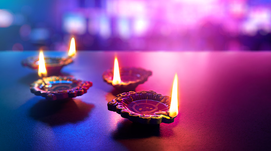 Happy Diwali - Colorful clay diya lamps lit during diwali celebration 1157054668