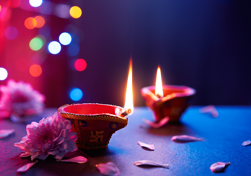 Happy Diwali - Diya lamps on floor with bokeh light background 1162080315