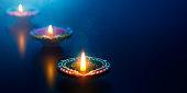 Happy Diwali - Diya oil lamps lit during celebration