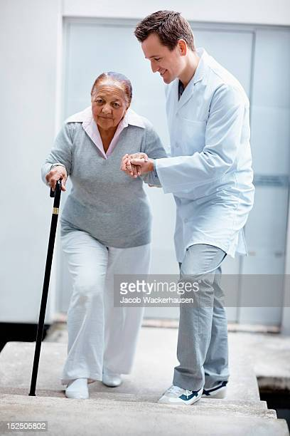Happy doctor assisting his patient while walking