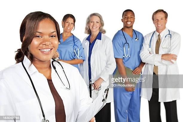 Happy Doctor in Front of Medical Team Lined Up, Isolated
