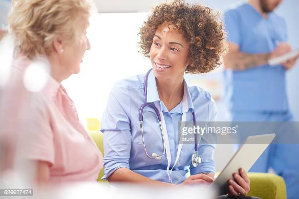 happy doctor with digital tablet and patient