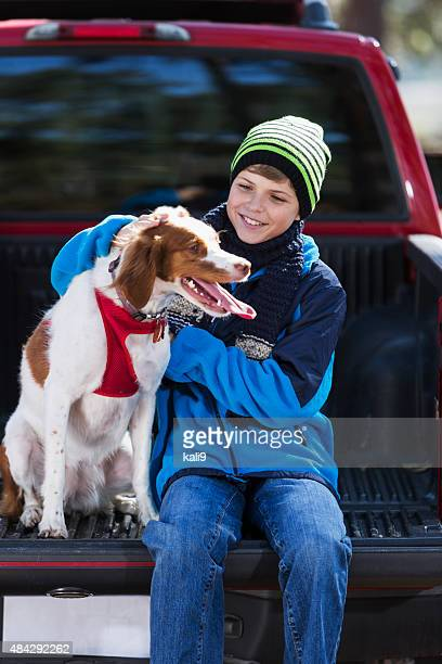 happy dog with a boy outdoors - brittany spaniel stock pictures, royalty-free photos & images