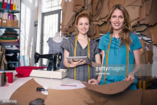 Happy dressmakers in their workshop
