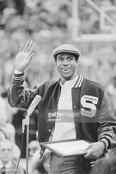 A happy Earvin 'Magic' Johnson waves to the more than 10000 Michigan State basketball fans who filled Jenison Fieldhouse to pay tribute to the NCAA...