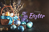 Happy Easter. Congratulatory easter background. Easter eggs and flowers. Selective focus.