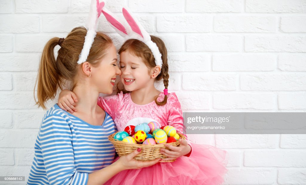 Happy easter! family mother and child daughter with ears hare getting ready for holiday : Stock Photo