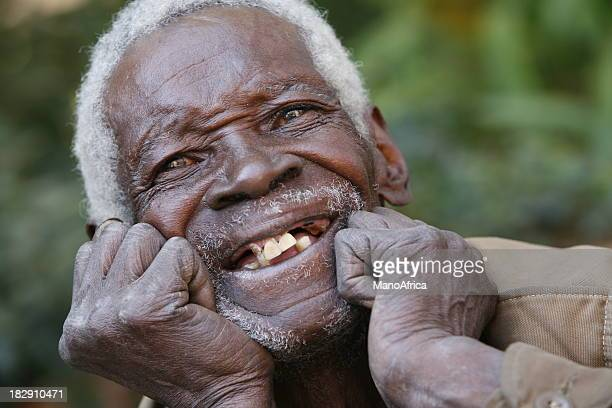 happy elderly african man portrait - missing teeth stock photos and pictures