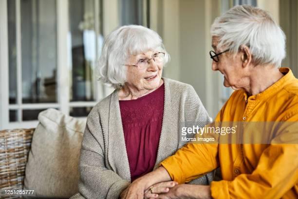 happy elderly couple at home - disruptaging stock-fotos und bilder