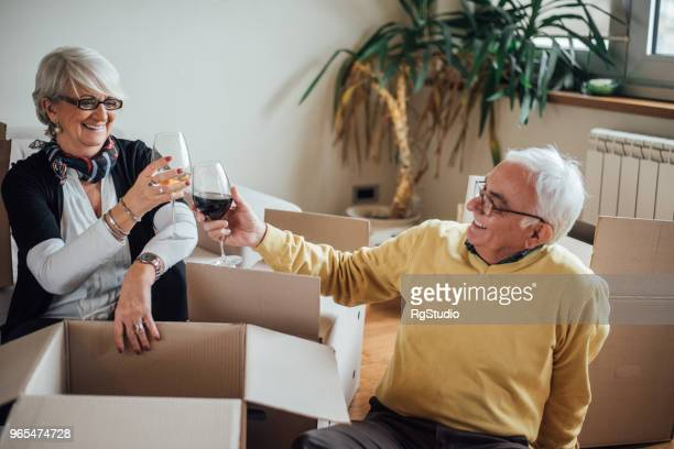 Happy elderly couple moving to new apartment