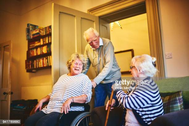 Happy elderly people at care home