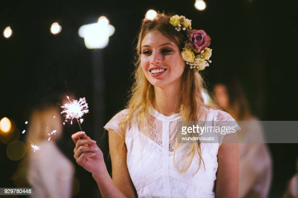 happy elegant bride celebrating with sparklers at wedding party - headwear stock pictures, royalty-free photos & images