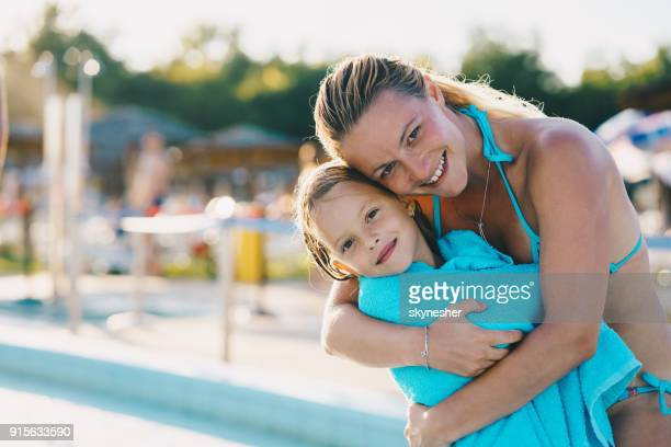 happy embraced mother and daughter enjoying in summer day. - mother daughter towel stock photos and pictures